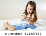 blond kid girl playing fun with ... | Shutterstock . vector #621857588