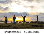 people rejoice in the rising sun | Shutterstock . vector #621886088