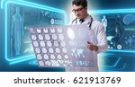 male doctor studying results of ... | Shutterstock . vector #621913769