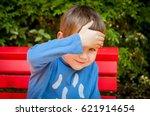 shy but curious little...   Shutterstock . vector #621914654
