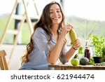beautiful happy woman sitting... | Shutterstock . vector #621944474
