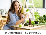 beautiful happy woman sitting... | Shutterstock . vector #621944570