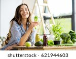 beautiful happy woman sitting... | Shutterstock . vector #621944603