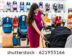young pregnant woman in shop of ...   Shutterstock . vector #621955166