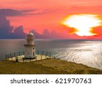 Small Lighthouse At The Sunset