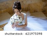 beauty bride in bridal gown... | Shutterstock . vector #621975398