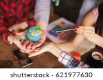 the globe in hands of people on ... | Shutterstock . vector #621977630