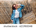 friendly laughing girl in jeans ... | Shutterstock . vector #621983348
