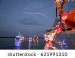 boats with holiday lights on... | Shutterstock . vector #621991310