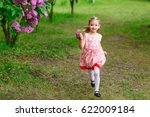 a little girl is running in the ... | Shutterstock . vector #622009184