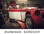 mechanic working on car body... | Shutterstock . vector #622021214