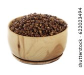 Small photo of Aframomum melegueta in wooden cup isolated