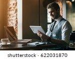 young handsome man working in... | Shutterstock . vector #622031870