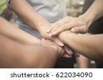 united hands close up  hands ...   Shutterstock . vector #622034090