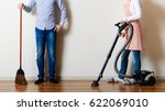 men and women cleaning the room | Shutterstock . vector #622069010