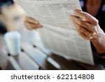 newspaper broadsheet held and... | Shutterstock . vector #622114808