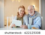 happy mature couple with... | Shutterstock . vector #622125338