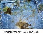 dirty black oil stain on jean...   Shutterstock . vector #622165658