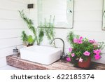 washbasin with pink flowers in... | Shutterstock . vector #622185374
