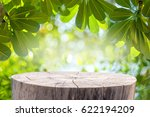 wood table with green leaves...   Shutterstock . vector #622194209