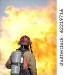 A Firefighter Watches A...