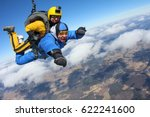 Small photo of Tandem skydiving. Give me hand.