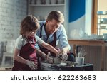 teacher and pupil in pottery | Shutterstock . vector #622263683
