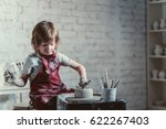 little boy in a pottery | Shutterstock . vector #622267403