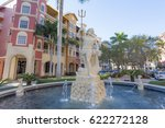 Small photo of Naples, Fl, USA - March 18, 2017: Neptune statue and fountain in Naples downtown. Florida, United States