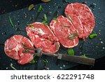 raw lamb leg steaks on stone... | Shutterstock . vector #622291748