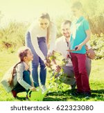 cheerful family of four... | Shutterstock . vector #622323080