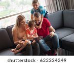 happy young family playing... | Shutterstock . vector #622334249