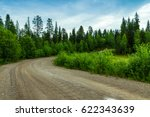 A Winding Dirt Road In The...