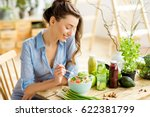 young and happy woman eating... | Shutterstock . vector #622381799