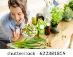 young and happy woman eating... | Shutterstock . vector #622381859