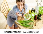 young and happy woman eating... | Shutterstock . vector #622381910