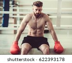 handsome bearded boxer with... | Shutterstock . vector #622393178