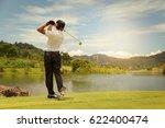 asian man playing golf on a golf | Shutterstock . vector #622400474