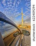 car in a field with wind power...   Shutterstock . vector #622409294