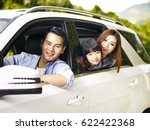 happy asian family traveling by ... | Shutterstock . vector #622422368