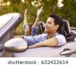 young asian couple riding in a... | Shutterstock . vector #622422614