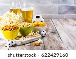 beer and snacks on wooden table.... | Shutterstock . vector #622429160