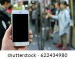 hand holding mockup smartphone... | Shutterstock . vector #622434980