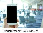 hand holding mockup smartphone... | Shutterstock . vector #622436024