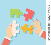 putting puzzle pieces together. ... | Shutterstock . vector #622449773