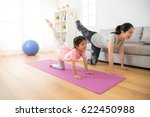 Small photo of asian pretty mother and her youth kid daughter in the gym center doing stretching fitness exercise yoga together, parent accompany children sport concept.