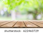 empty wooden table with blurred ... | Shutterstock . vector #622463729
