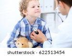 doctor examining a child ... | Shutterstock . vector #622513454