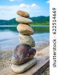 photo of stones balanced on top ... | Shutterstock . vector #622514669