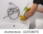 plumber apply silicone sealant... | Shutterstock . vector #622528073